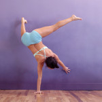 Desi - one-arm handstand on wall - straight leg